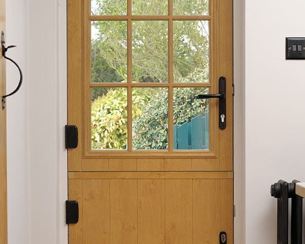 Wooden style solid door with panel glazing