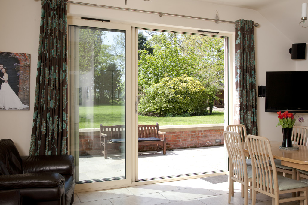 Internal shot of sliding patio doors with garden and patio outlook