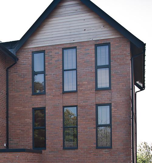 Modern property with dark grey aluminium windows Truro