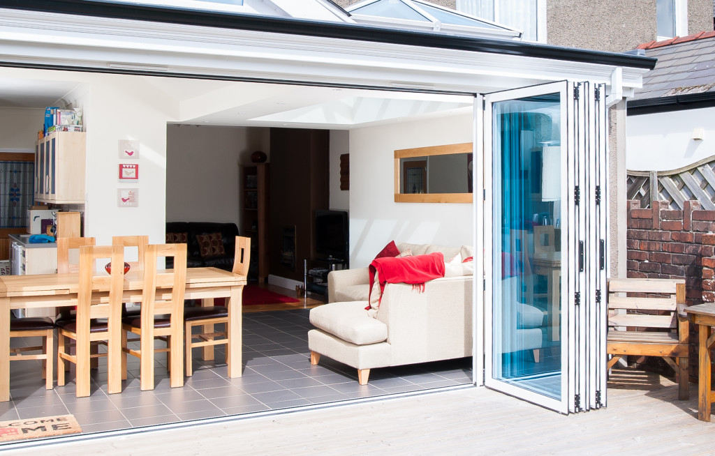 White uPVC Bi-Fold Doors fully open on a new extension