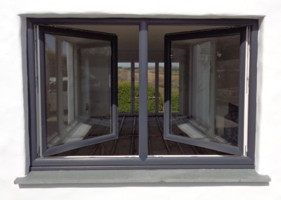 Kommerling tilt and turn window in anthracite grey. In 'turn' position