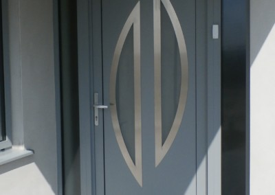 Aluminium entrance door glazed with slate grey hallmark panel